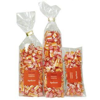 drei verschiedene Tütengrößen gefüllt mit Rockbonbons Geschmack Aprikose