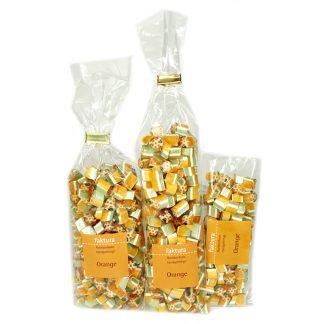 drei verschiedene Tütengrößen gefüllt mit Rockbonbons Geschmack Orange